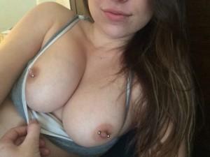 Flashing her pierced nips