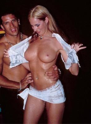 Peeling off her wet shirt