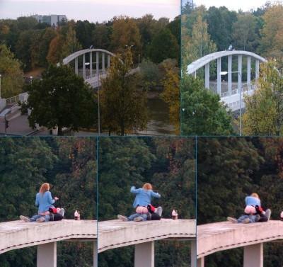 Couple having fun on top of bridge