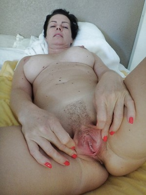 Milf spreading her pussy wide