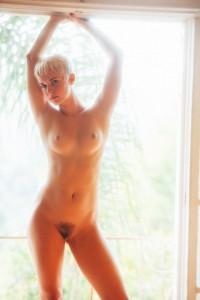 Naked in the doorway
