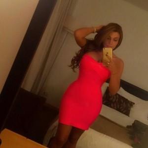 DJ Mariana Castillo - Voluptuous selfie in red/orange minidress