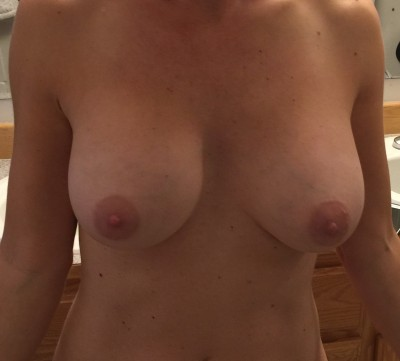 Sharing my wife's tits with ya!