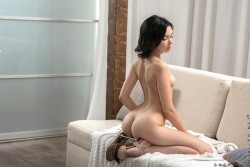 Sheri Vi kneeling on couch