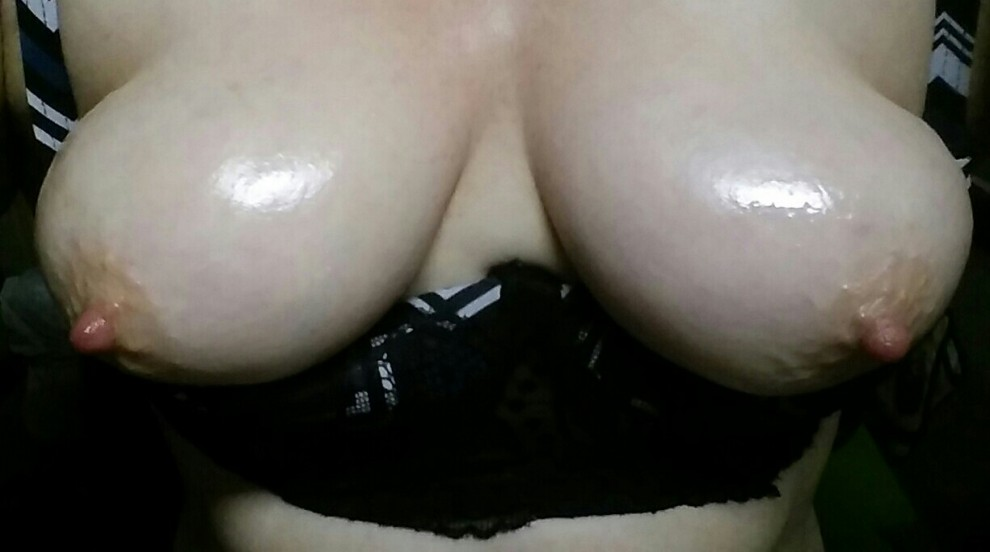This horny MILF is craving some cock. Would you fuck my oiled up tits?