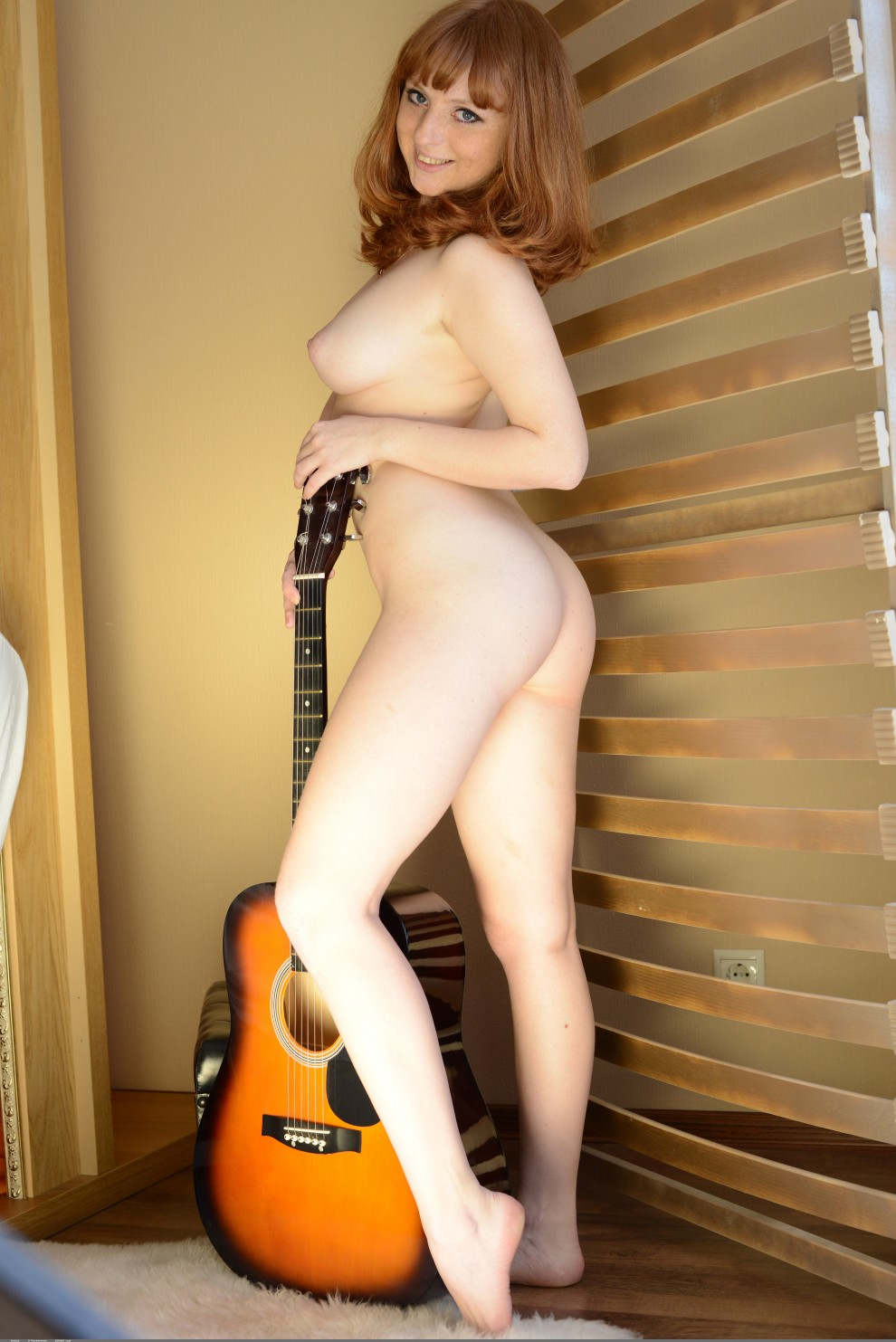 Who do you fancy more? Her Ass or Guitar?