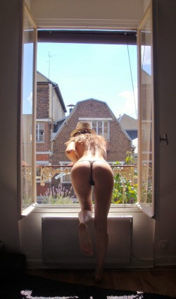 Bent over the balcony