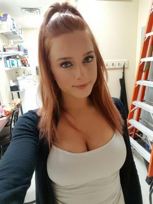 Busty redhead