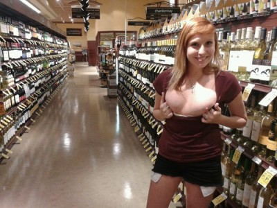 College girl showing tits in wine shop [IMG]