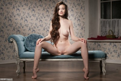 Emily Bloom sat naked on a chaise longue: