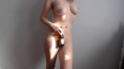 Holdin a beer.