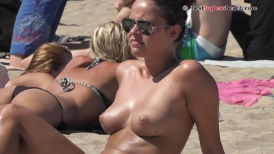 Pretty brunette Topless on the Beach