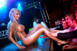 """Russian """"stage-performer"""" Katya Sambuca on stage letting the audience touch her legs..."""