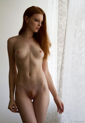 Standing by the curtains