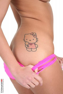 Angelica Black showing her Hello Kitty tattoo.