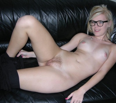 Blonde with glasses on the couch