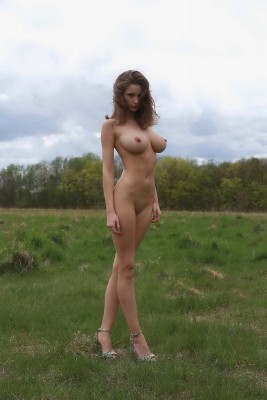 Busty girl in field
