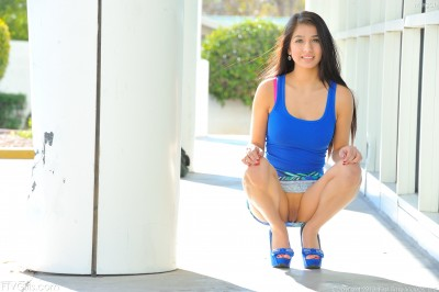 Crouching in blue