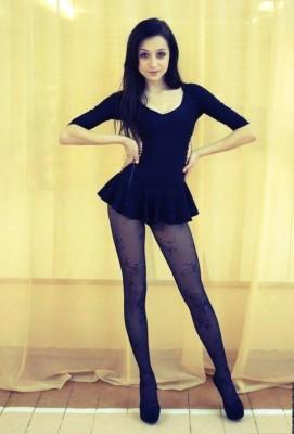Cute brunette in tights