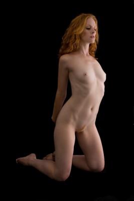 Hands behind her back
