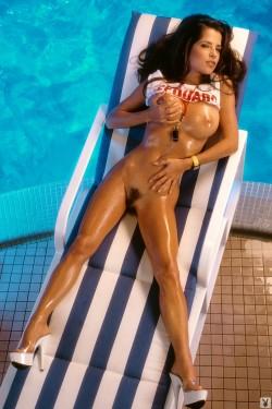 Kelly Monaco by the pool.