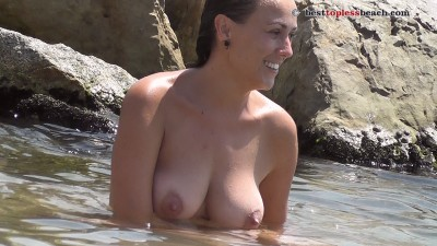 Sexy brunette Topless Beach