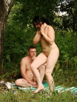 A totally nude couple kicking back plus soothing about a bare beach