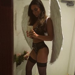Beaut in stockings and wings