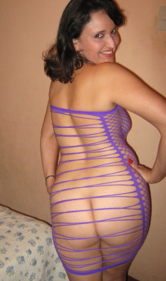 My fishnet MILF in her purple seduction. Rear view...