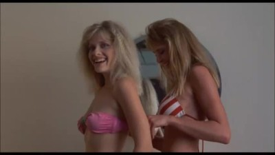 """Barbara Crampton and Kathleen Kinmont strip in """"Fraternity Vacation"""""""