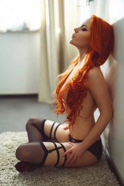Redhead in black stockings