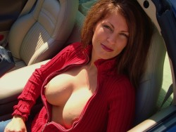 Redheaded MILF with great boobs
