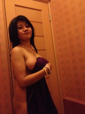Sexy Asian barely in a towel