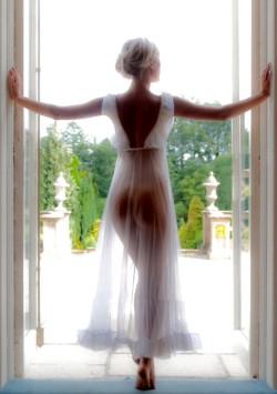White negligee in a doorway.
