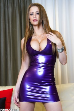 Emily Addison squeezed into latex