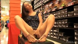 Girl having a lot of fun in a shoe store