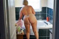 Mom's ass getting in the tub...