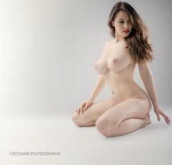 Pale stacked brunette