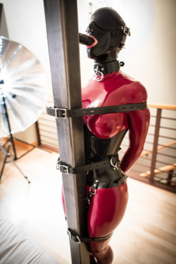Practicing hooded and belt-strapped