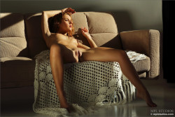 Redhead cutie Colette on the couch