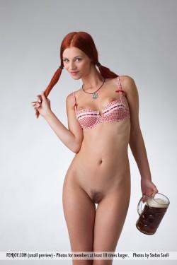 Stunning redhead with a huge mug of beer