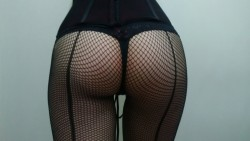 That fishnet is really gettin' stretched by those cheeks.