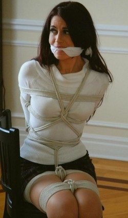 Tied up with her clothes on