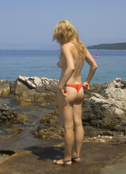 Wife loves to be in public wearing only her bikini bottoms