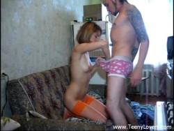 Teenage in orange stockings takes sausage