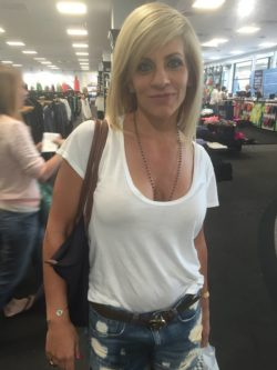 Blonde MILF slut showing cleavage