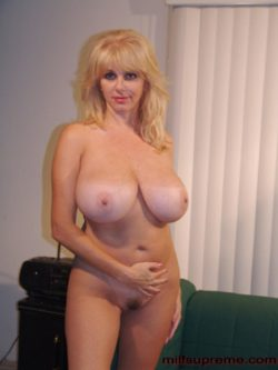 Blonde bombshell with huge tits and a nicely trimmed muff