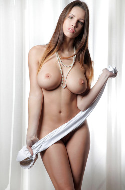 Busty petite with a white towel and a pearl necklace