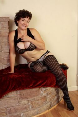 Busty woman in striped stockings