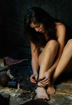 Examining her cuffs